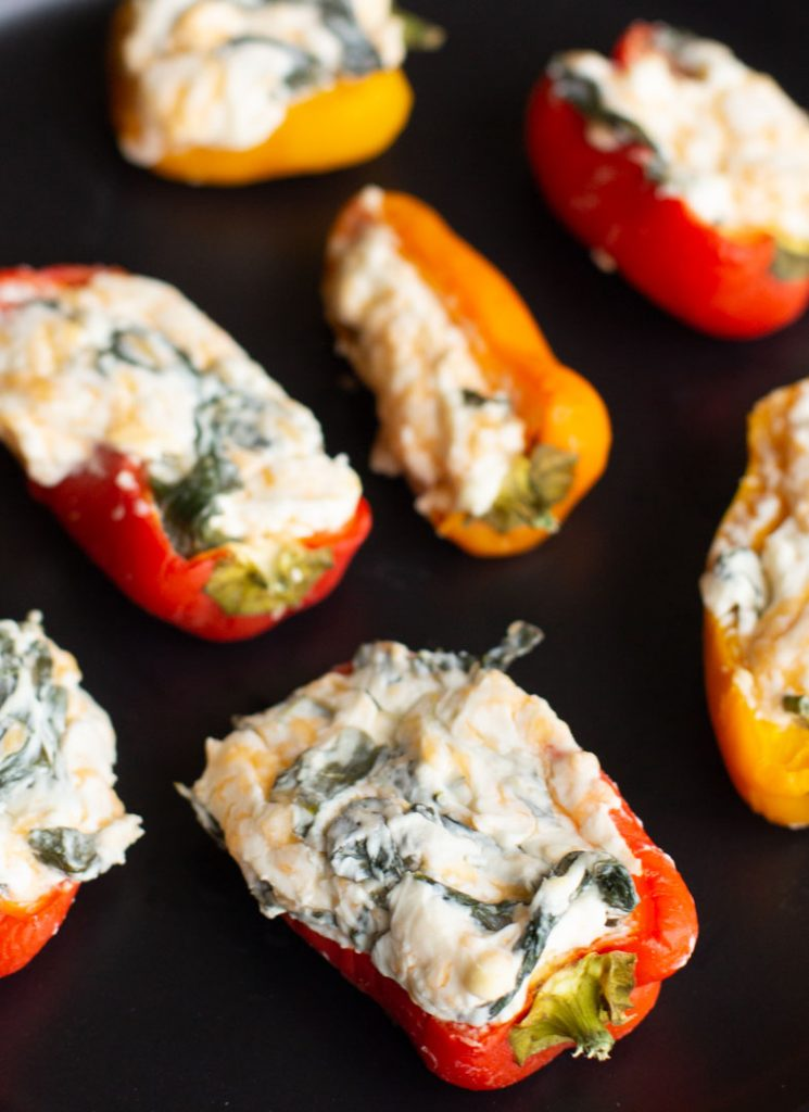 easy stuffed peppers on a plate with cream cheese and spinach