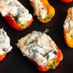 Spinach and Cheese Stuffed Peppers are a super easy party pleaser. No need to worry about spice, these easy stuffed peppers use sweet peppers, cream cheese and spinach to create awesome finger food great for any occasion.