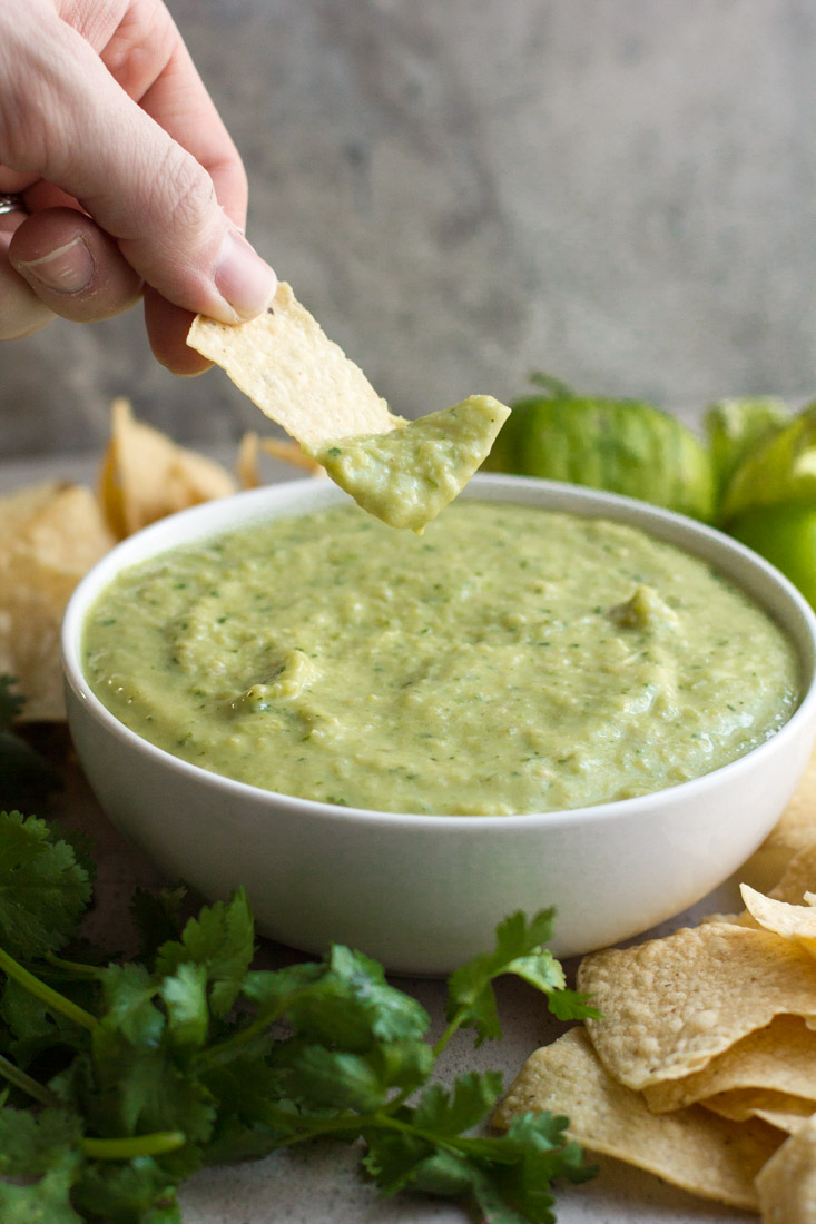 With tomatillos and avocados, this creamy, mild salsa verde is based on my favorite Tex-Mex restaurant recipe. It is sure to become a kitchen staple!