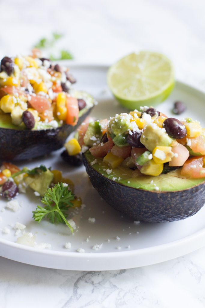Avocados stuffed with my favorite veggies and beans. The perfect afternoon or post-workout snack.