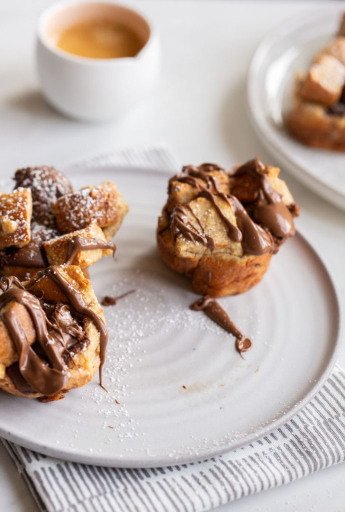 french toast cups stuffed with nutella and topped with more nutella and powdered sugar