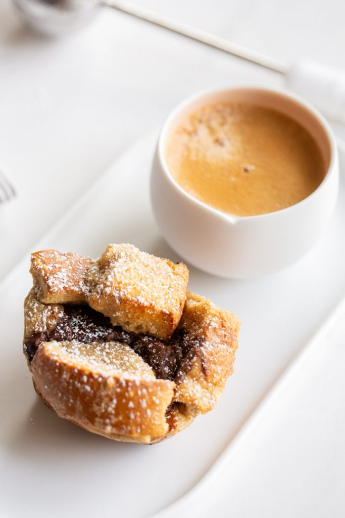 french toast cups stuffed with nutella and dusted with powdered sugar and served with espresso