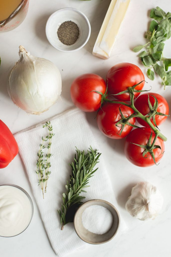 the ingredients for roasted red pepper and tomato soup sitting on a table