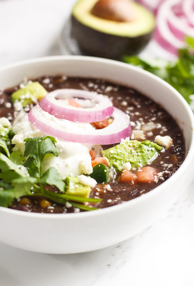This slow cooker black bean soup is full of hearty Tex-Mex flavors and uses dried black beans that don't require soaking. Perfect hands-off recipe for fall, winter, cold weather months, or anytime you want to use a crock pot instead!