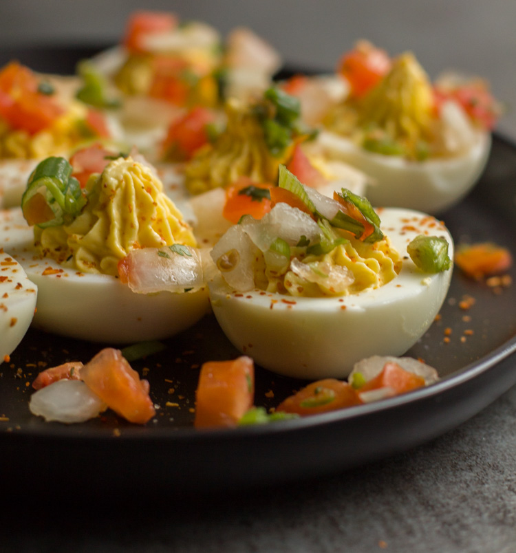 deviled eggs topped with pico de gallo