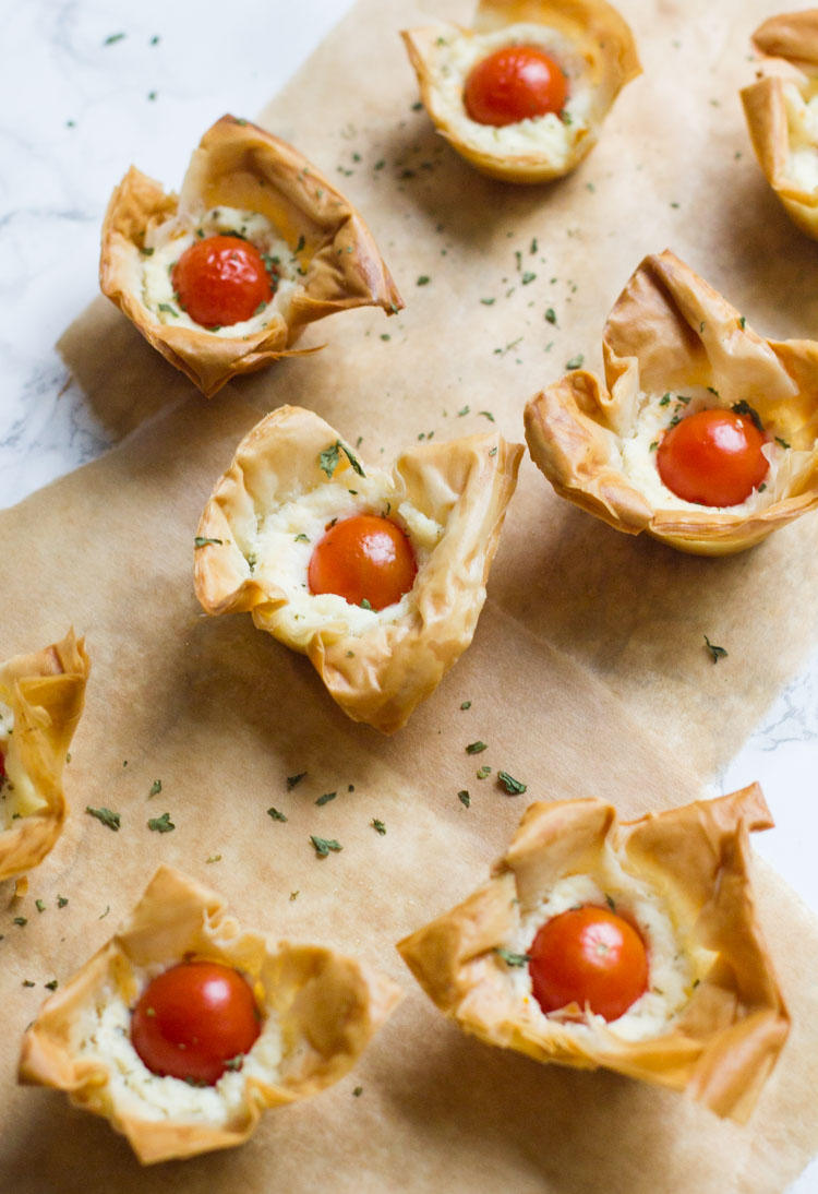 These fun tomato ricotta phyllo cups are really easy to prepare and make the best appetizer for your next party or brunch.