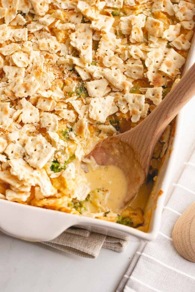 broccoli cheddar casserole topped with ritz crackers or saltines with a spoon
