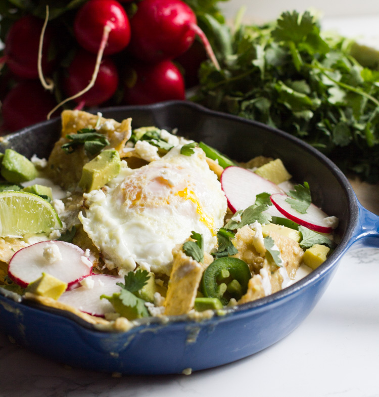 Chilaquiles verdes are a tex-mex brunch mainstay. Tossed in salsa verde and topped with an egg, cream and cheese, they're the perfect way to start your day.