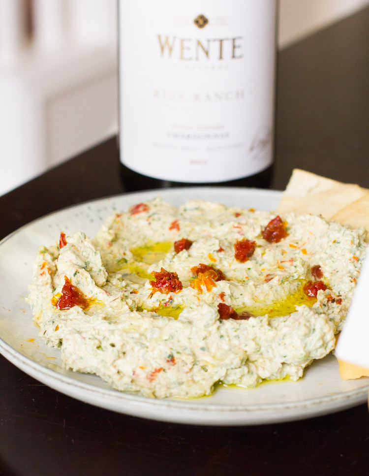 This whipped feta dip with spinach and sundried tomatoes is the perfect party dip for a small or large gathering and pairs wonderfully with a glass of white wine.
