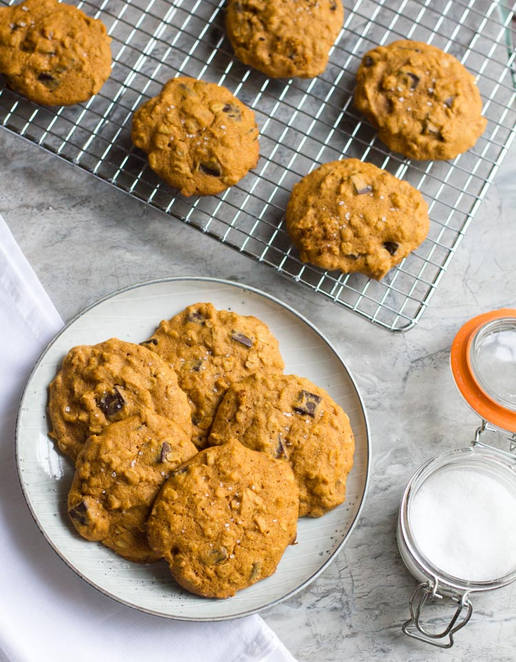 Pumpkin Oatmeal Cookies with Dark Chocolate and Sea Salt are the best way to celebrate the fall baking season. Enjoy with a nice cup of coffee and a comfy blanket.