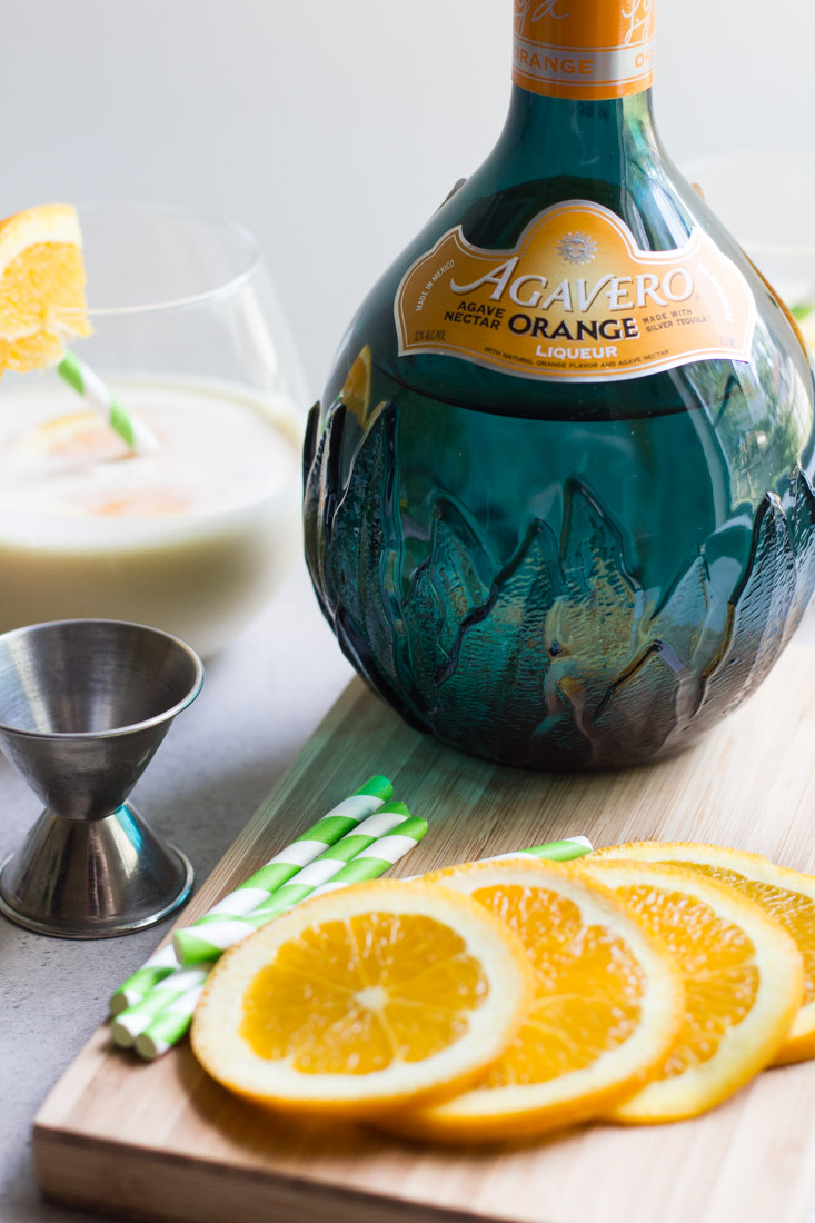 A creamy blend of orange and vanilla, this recipe for the ultimate creamsicle margarita is always a hit! #ad