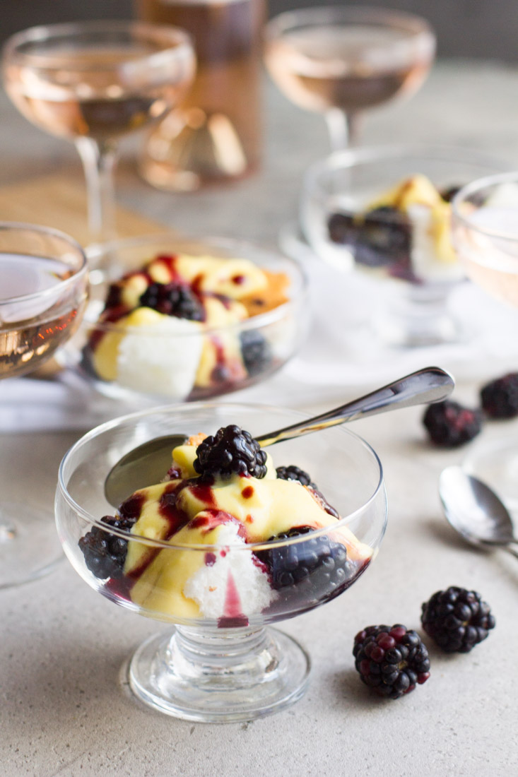 Champagne mousse, or sabayon, is a fast and light dessert served atop angel food cake and topped with blackberries. The perfect light, yet flavorful dessert to be enjoyed in the fall or year round! #ad