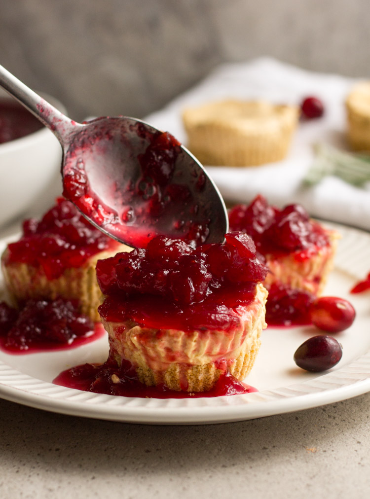 No bake pumpkin cheesecakes make party planning a breeze. Prep these mini cheesecakes and the cranberry topping ahead and chill in the fridge until the big day. Perfect for Thanksgiving and the holiday season. #ad