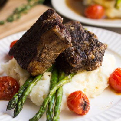A delicious, decadent and easy dish - this recipe for Slow Cooker Balsamic Braised Short Ribs is excellent for a dinner party or romantic night in. Pair with a glass of your favorite red wine!