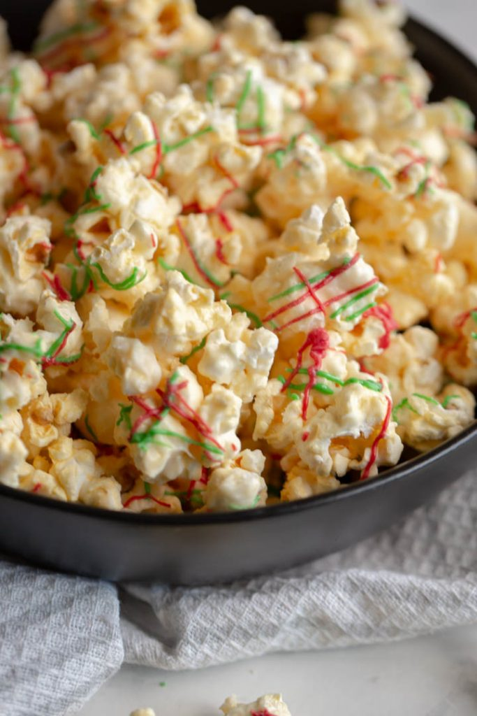 This sweet and salty popcorn recipe is made using white chocolate. It makes the perfect movie night snack, party favor, or christmas gift!
