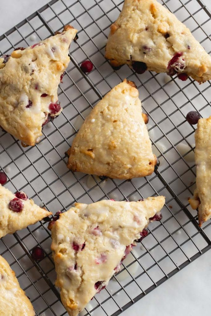 cranberry scones laid on a cooling rack