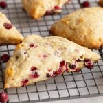 These cranberry scones make the ultimate breakfast pastry. They're soft and moist like a good muffin and flaky like a biscuit. Cranberries make this recipe excellent during the holidays, but can be swapped for other berries throughout the year.