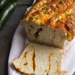 loaf of jalapeno cheese bread on a cloth