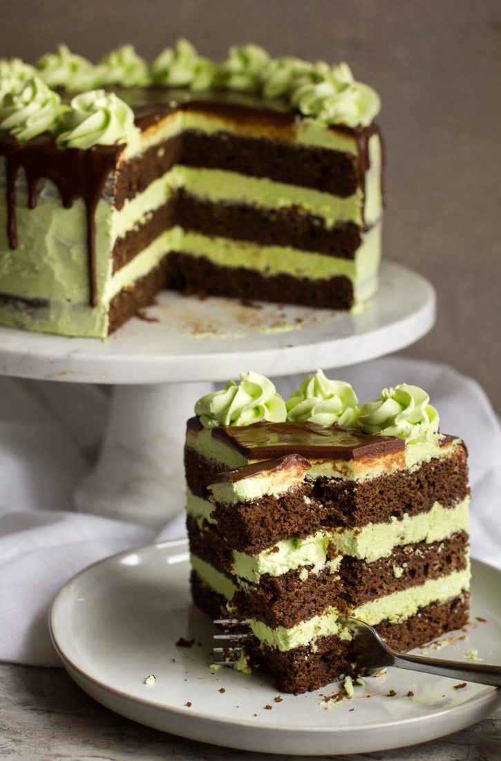 mint julep cake with a slice removed and a fork cutting through it
