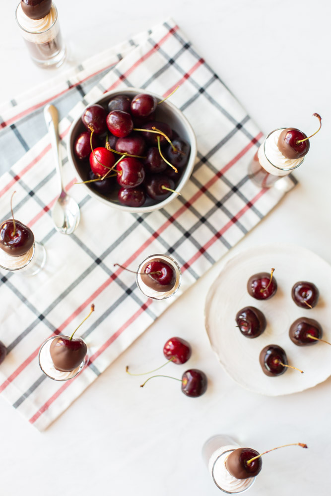 wine soaked choclate covered cherries on a table