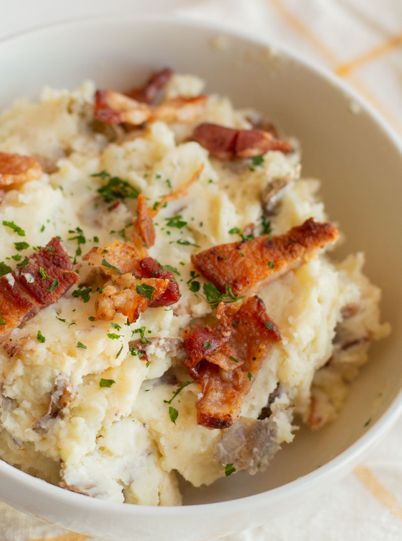 Instant Pot Jalapeno Popper Mashed Potatoes in a bowl with bacon and parsley on top