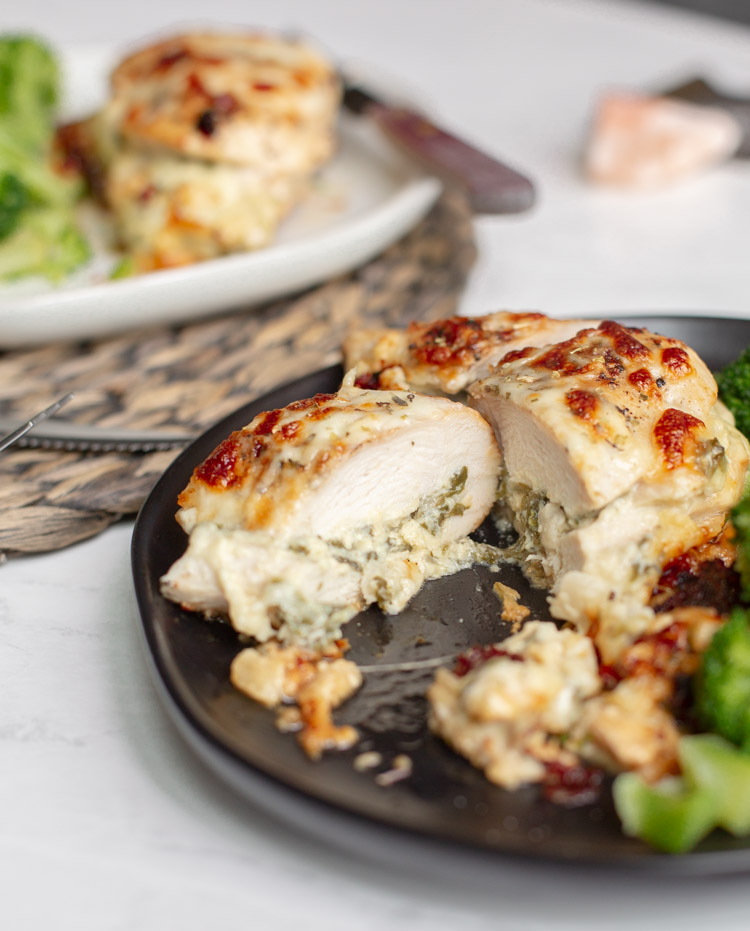 spinach artichoke stuffed chicken on a plate