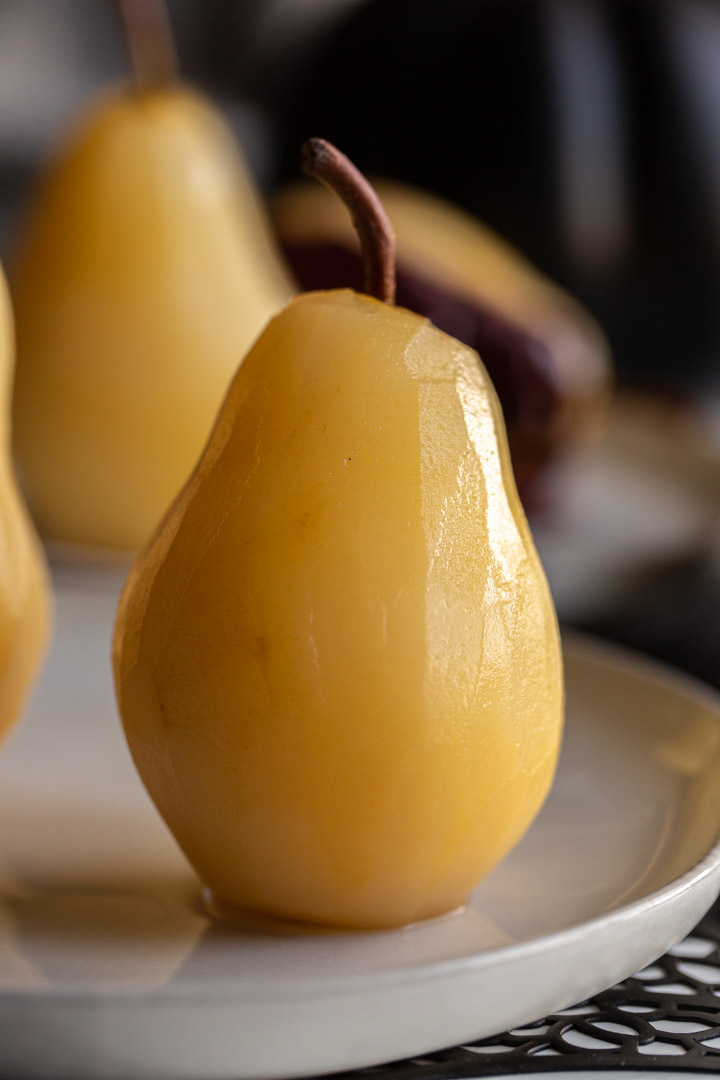 easy poached pears on a plate