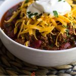 Instant Pot Chili is an easy one pot dish. This recipe uses beef, beans, salsa and spices to give it a truly awesome taste - perfect for tailgating, serving at a bbq cookout, topping chili dogs or as frito pie!