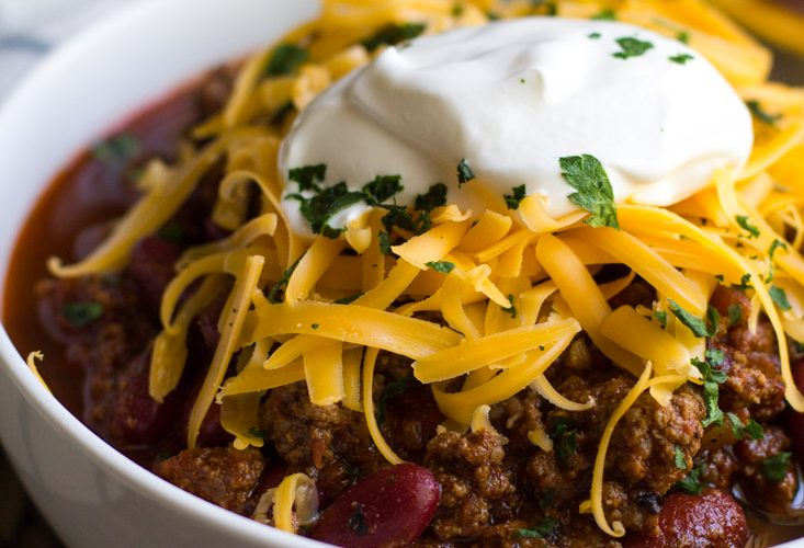 Instant Pot Chili in a bowl with cheese and sour cream