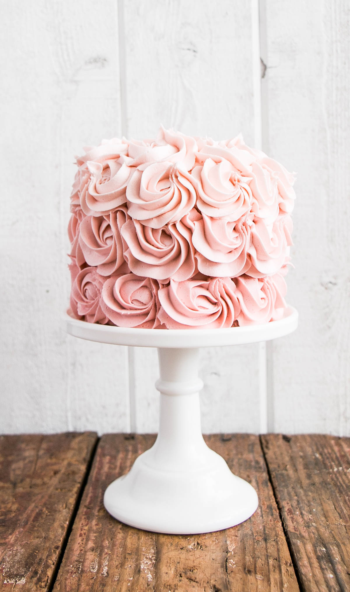 ombre rosette cake on a stand