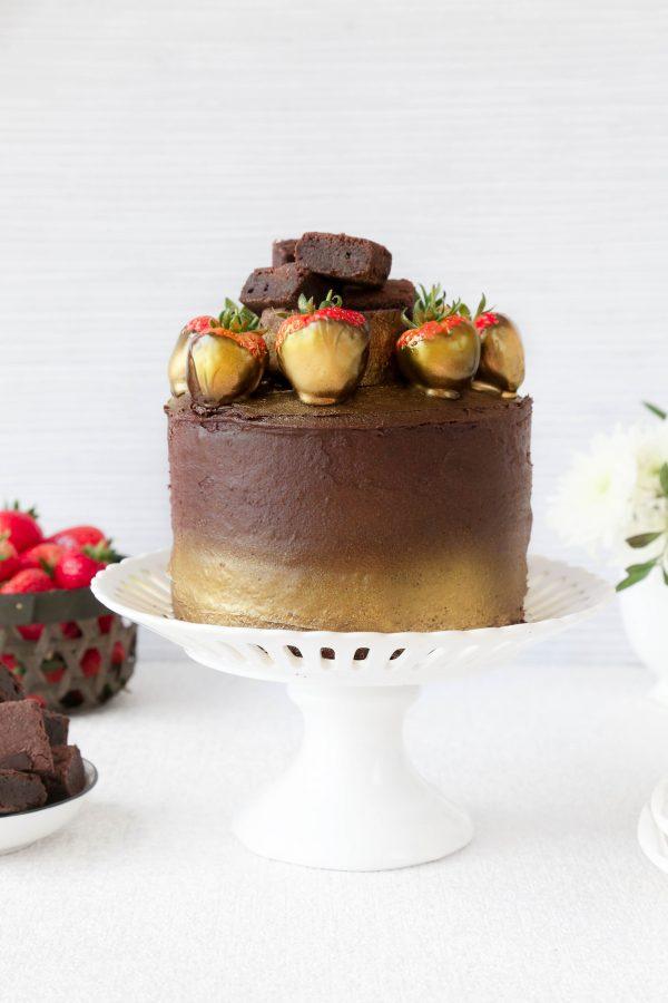 chocolate fudge layer cake on a stand