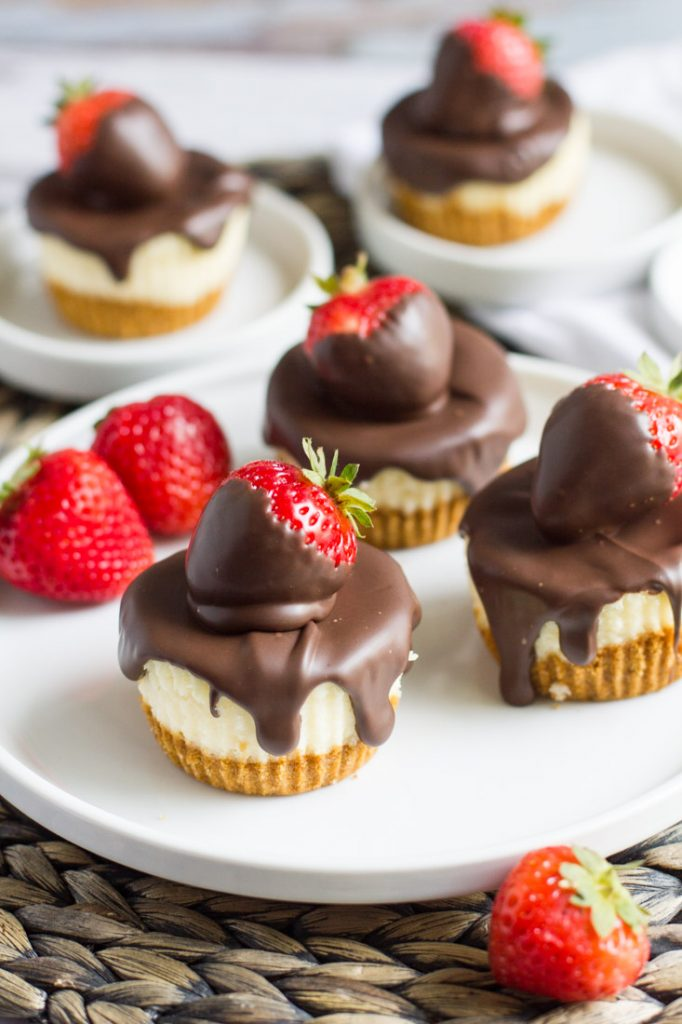 chocolate covered strawberry cheesecakes on a plate