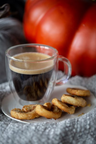 pumpkin spice palmiers on a blanket with a cup of coffee