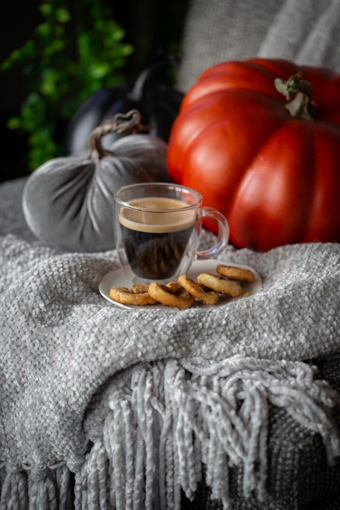 pumpkin spice palmiers and coffee on a blanket with pumpkins