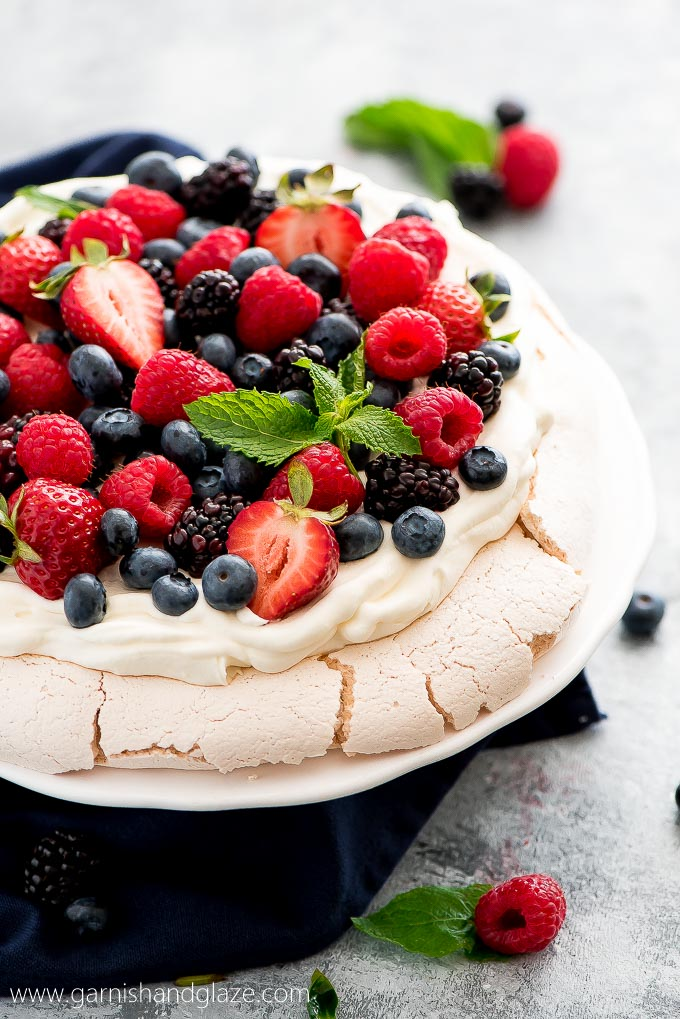 mixed berry pavlova with raspberries, strawberries and blueberries