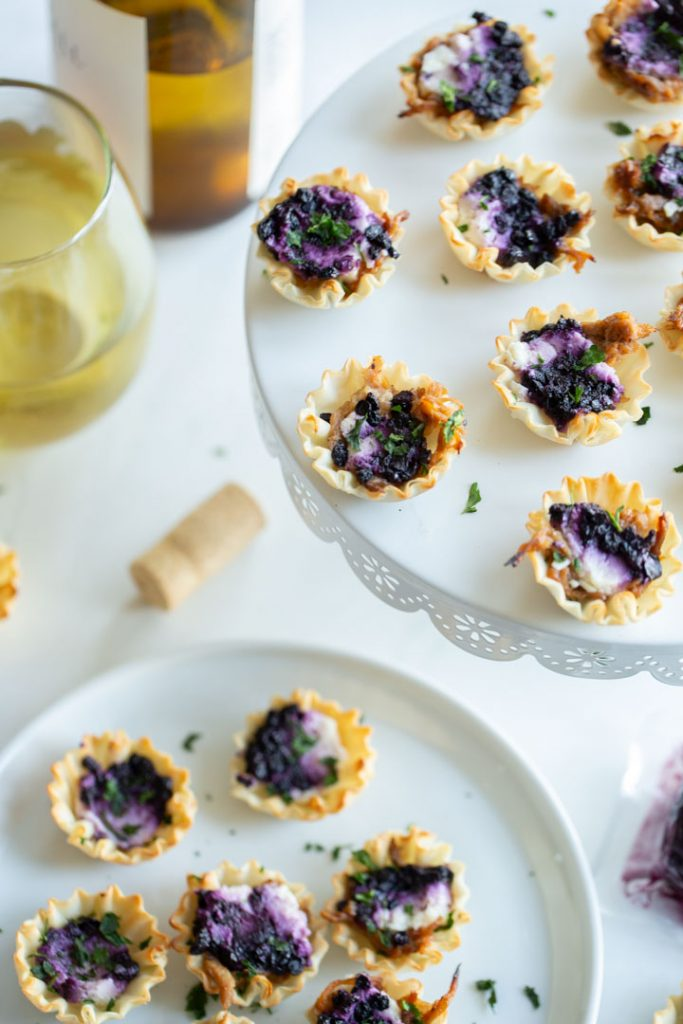 blueberry goat cheese appetizer bites on a serving plate