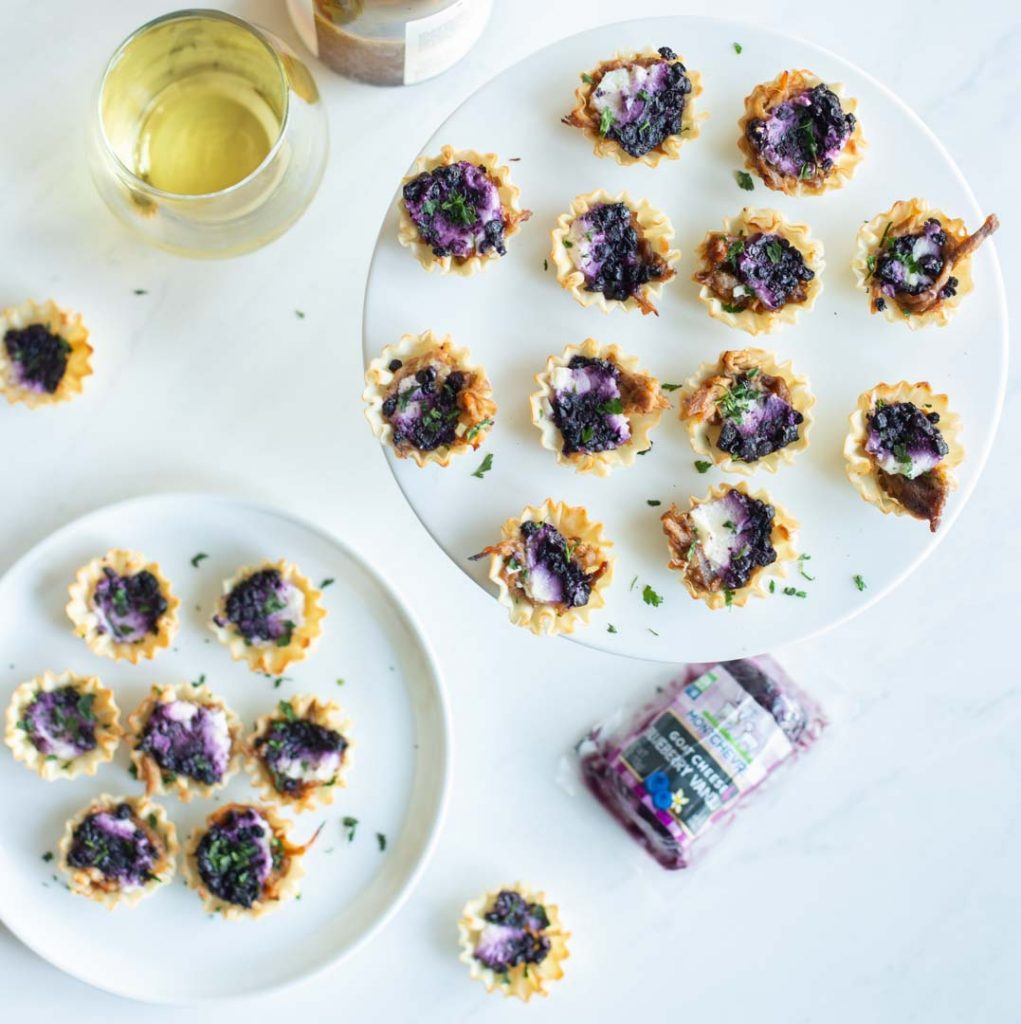 blueberry goat cheese appetizer bites on a plate