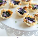 #AD This easy holiday appetizer uses minimal ingredients and yields maximum flavor. Blueberry Goat Cheese Appetizer bites are flaky, delicious and packed with pulled pork and blueberry vanilla goat cheese. #montchevreisgoat