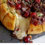 #AD An easy, elegant appetizer perfectly suited for holiday entertaining or sharing with a loved one. This Baked Brie with Cranberries and Bacon is a pull apart bread with Joan of Arc Brie and a cranberry bacon jam. #JoanofArcBrie #BrieFabulous