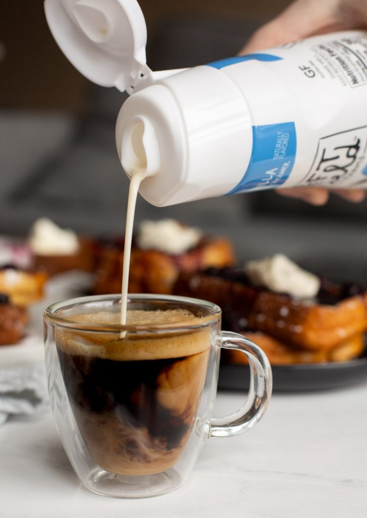 creamer being poured into coffee