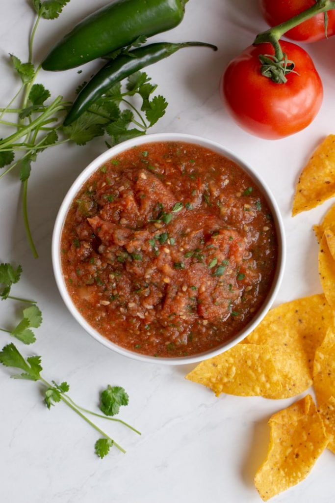 roasted red salsa in a bowl on a table