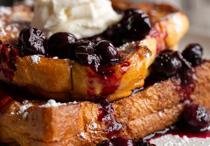 stuffed french toast with blueberry sauce and whipped cream on top