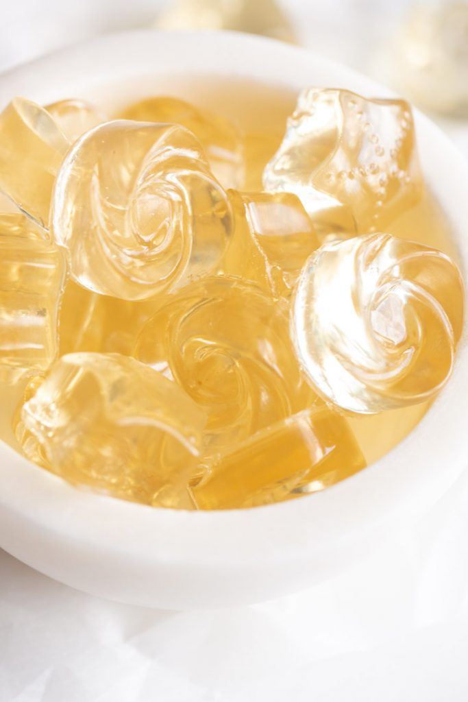 champagne gummies in a bowl