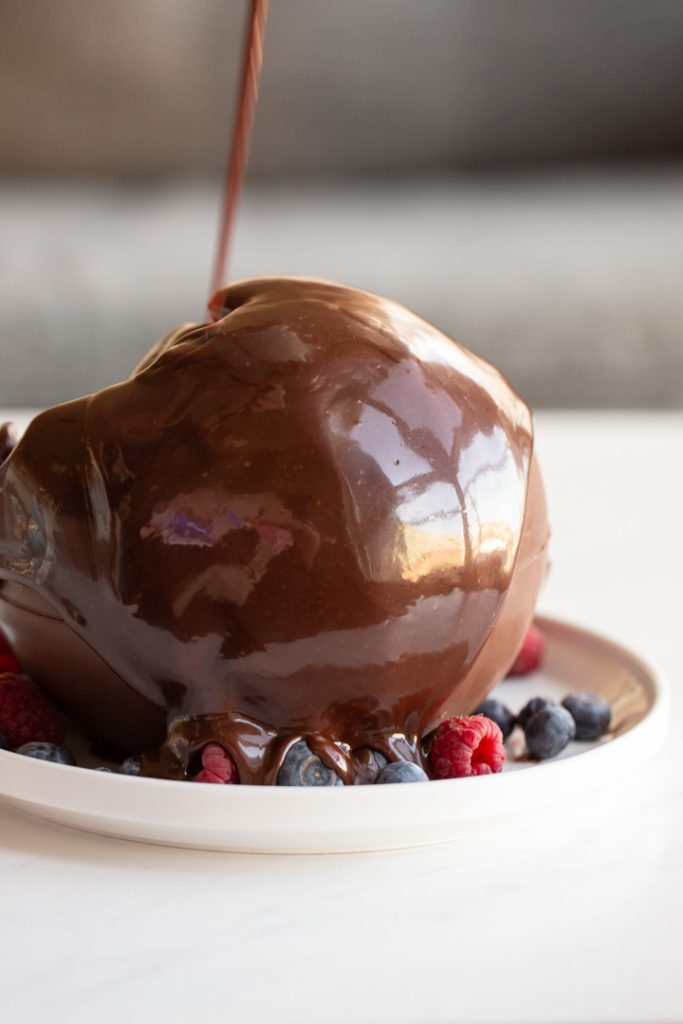 chocolate ball dessert melted with hot fudge