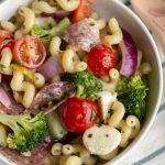 Italian pasta salad with cavatappi pasta, tomatoes, broccoli, peppers, salami and cheese