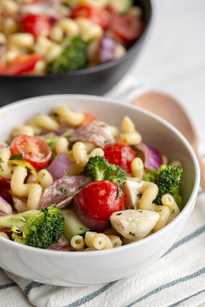 Italian Pasta Salad with cavatappi pasta, tomatoes, broccoli, cheese and salami