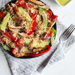 This fajita chicken salad is a mix of grilled fajita chicken, peppers, onions, tomatoes and more laid atop a bed of romaine lettuce and topped with a bright and refreshing avocado lime dressing.