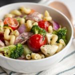 This Italian Pasta Salad is an easy dish to make ahead and bring to a potluck. Packed with salami, cheese, cucumbers, peppers and more, this pasta salad is a total crowd pleaser!