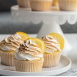 Delicious vanilla cake and a lemon marshmallow frosting make these amazing lemon meringue cupcakes. Top it with a candied lemon and your guests will fall in love!