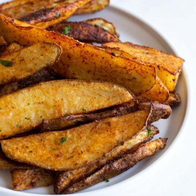 seasoned potato wedges on a plate